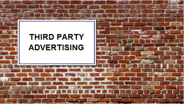 brick wall with sign for third party advertising
